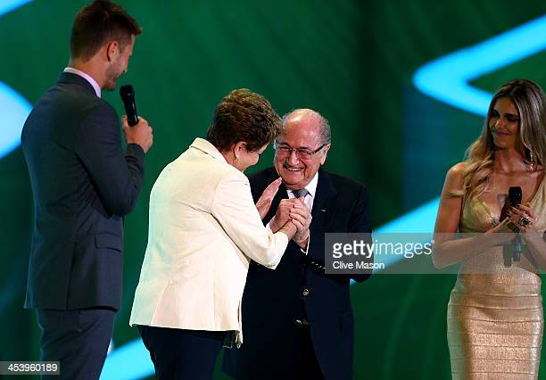 President Joseph S Blatter greets Brazil President Dilma Rousseff on stage next to host Fernanda Lima and Rodrigo Hilbert before the Final Draw for...