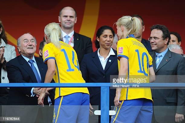 President Joseph S Blatter hands Josefine Oqvist of Sweden her medal as LOC President Steffi Jones congratulates Sofia Jakobsson after the FIFA...