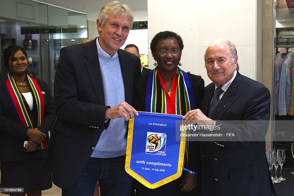 FIFA president Joseph S. Blatter (R) hands-over a commemorative pennant to Bart Dorrestein (L), Chairman of Legacy Group, during the opening of a new bridge building at 'The Michelangelo' hotel on June 4, 2010 in Johannesburg, South Africa.