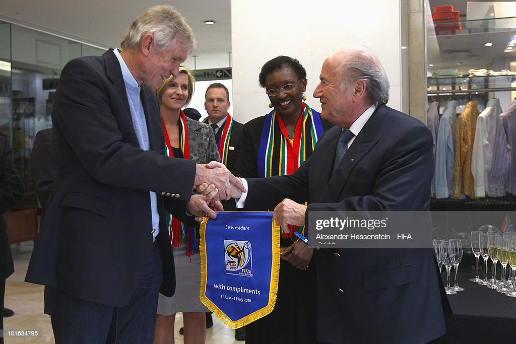 FIFA president Joseph S. Blatter (R) hands-over a commemorative pennant to Bart Dorrestein (L), Chairman of Legacy Group during the opening of a new bridge building at 'The Michelangelo' hotel on June 4, 2010 in Johannesburg, South Africa.