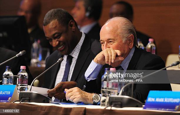 FIFA president Joseph S Blatter laughes with the Chairman of the CFU Normalisation Committee Jeffrey Webb during the XXXV CFU Ordinary Congress at...