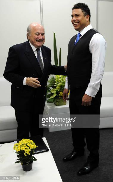 President Joseph S Blatter laughs with Brazilian legend Ronaldo before the Preliminary Draw of the 2014 FIFA World Cup at Marina Da Gloria on July 30...