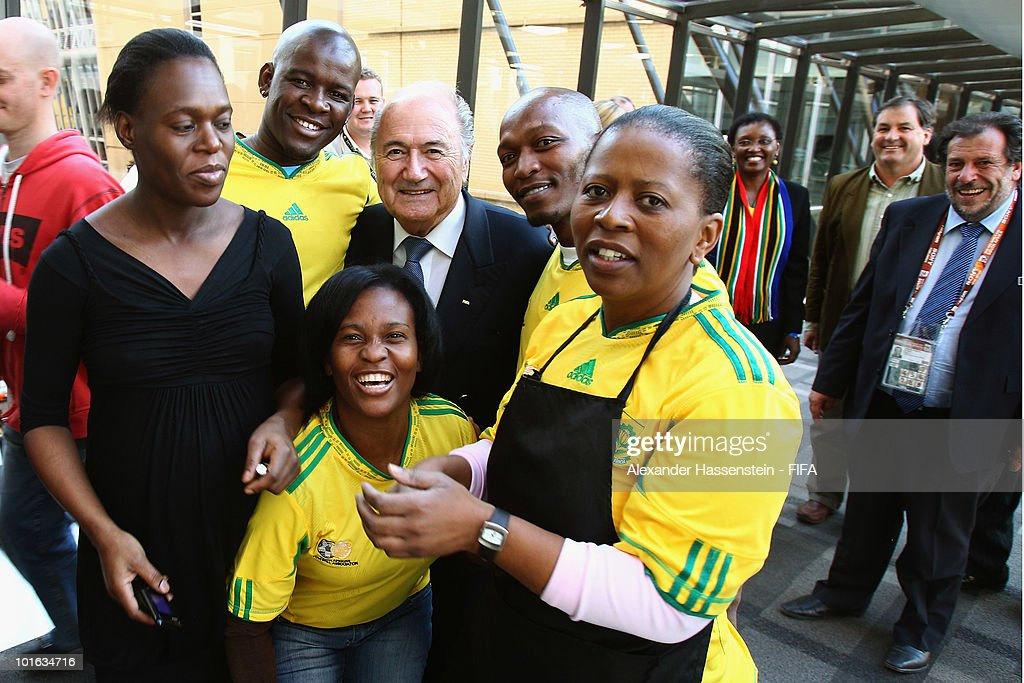 FIFA president Joseph S. Blatter (C) poses with employees after a reception at 'The Michelangelo' hotel on June 4, 2010 in Johannesburg, South Africa.