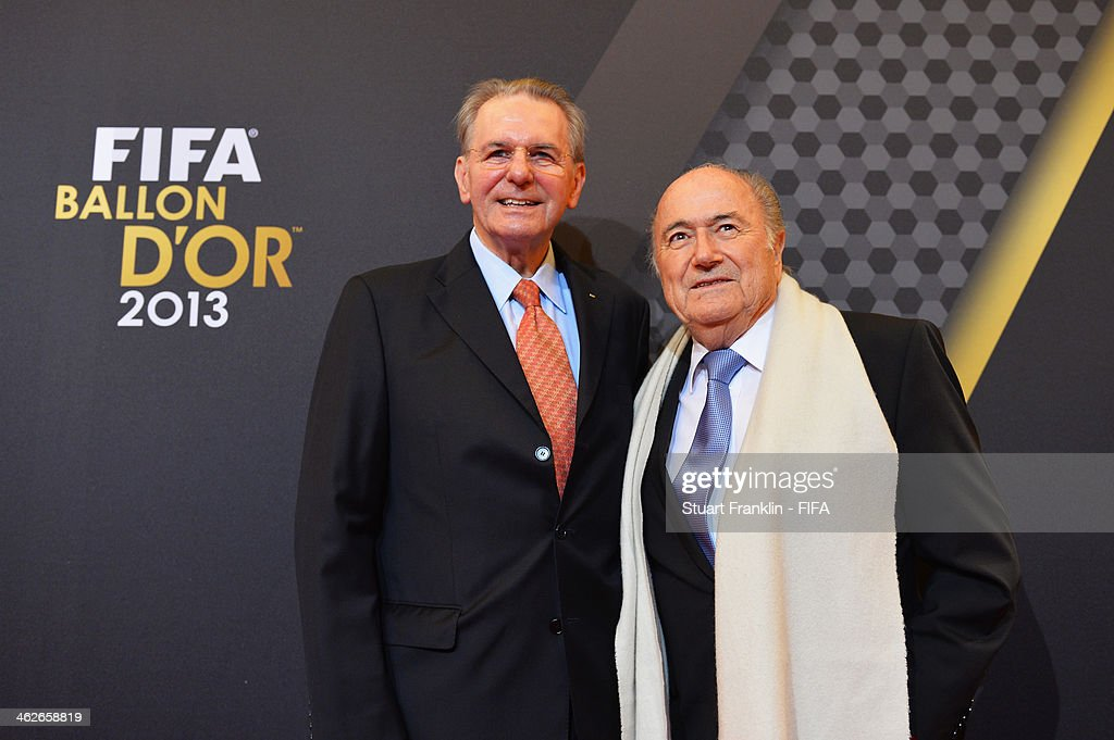 President Joseph S. Blatter (R) poses with former International Olympic Committee (IOC) president Jacques Rogge as they arrive during the FIFA Ballon d'Or Gala 2013 at the Kongresshaus on January 13, 2014 in Zurich, Switzerland.