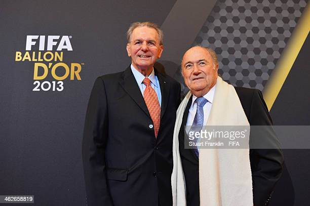 President Joseph S Blatter poses with former International Olympic Committee president Jacques Rogge as they arrive during the FIFA Ballon d'Or Gala...