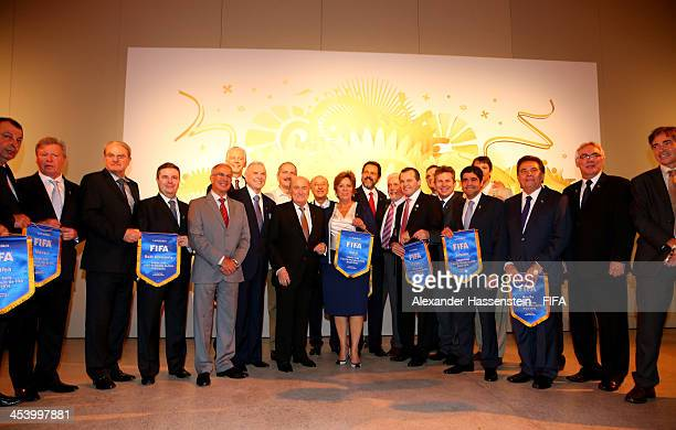President Joseph S Blatter poses with the governors of the 12 World Cup host cities after the Final Draw for the 2014 FIFA World Cup Brazil at Costa...