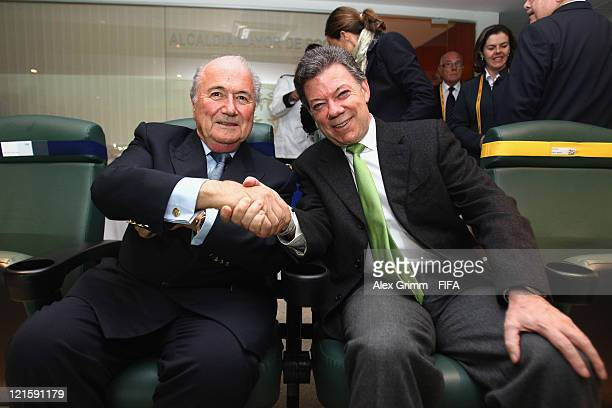 President Joseph S. Blatter shakes hands with Colombian President Juan Manuel Santos before the FIFA U-20 World Cup 2011 final between Brazil and...