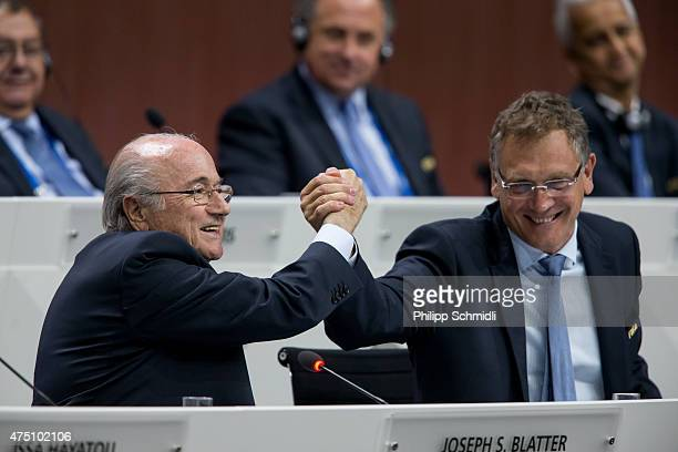 President Joseph S Blatter shakes hands with FIFA Secretary General Jerome Valcke during the 65th FIFA Congress at Hallenstadion on May 29 2015 in...