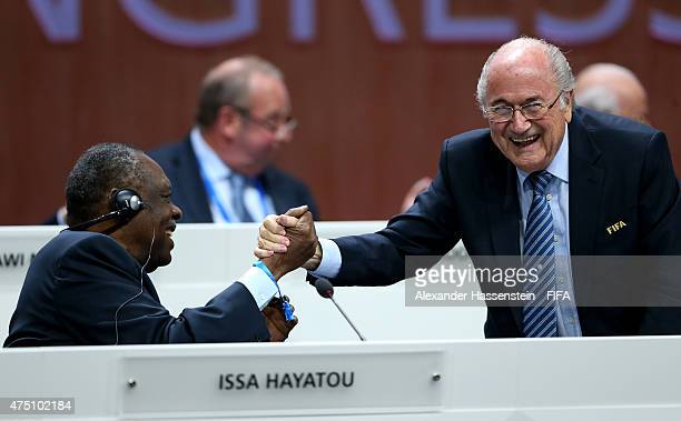 President Joseph S. Blatter shakes hands with FIFA Senior Vice President Issa Hayatou of Cameroon during the 65th FIFA Congress at the Hallenstadion...