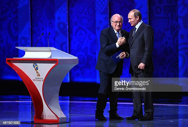 President Joseph S Blatter shakes hands with Vladimir Putin President of Russia during the Preliminary Draw of the 2018 FIFA World Cup in Russia at...