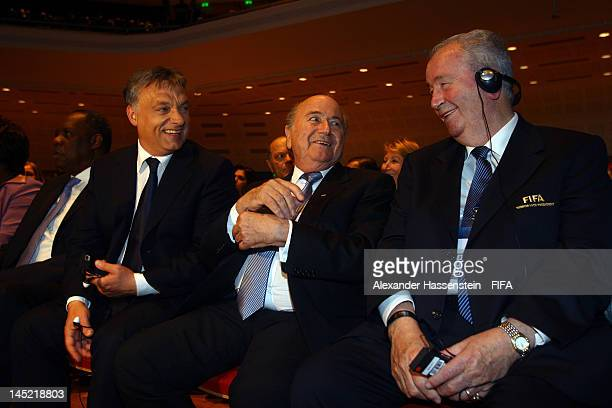 President Joseph S Blatter smiles with Hungarian Prime Minister Viktor Orban and FIFA vice president Julio Grondona prior the Opening Ceremony for...