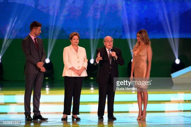 President Joseph S Blatter speaks to the audience next to Brazil's President Dilma Rousseff and hosts Fernanda Lima and Rodrigo Hilbert before the...