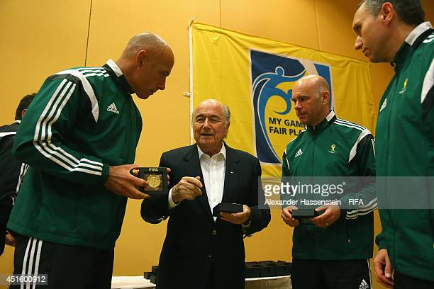 President Joseph S Blatter talks to 2014 FIFA World Cup Referee Howard Webb of England and his assistens Michael Mullarkey and Darren Cann at the...