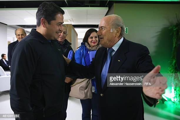 President Joseph S. Blatter talks to Honduras' President Juan Orlando Hernandez, President of Atletico Paranaense prior to the 2014 FIFA World Cup...