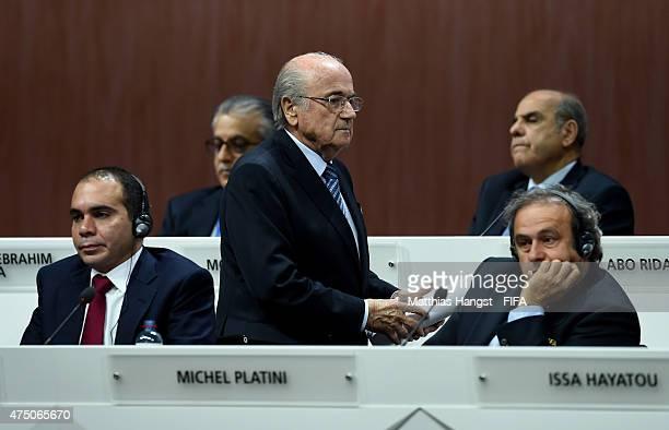 President Joseph S Blatter walks past FIFA Presidential candidate HRH Prince Ali Bin Al Hussein of Jordan and UEFA President Michel Platini of France...