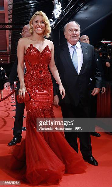 FIFA president Joseph SBlatter arrives on the red carpet with pop star Shakira prior to the FIFA Ballon d'Or Gala 2011 at the Kongresshaus on January...