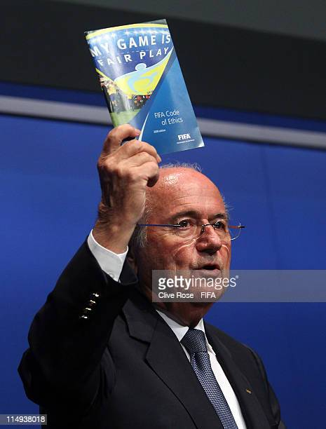 President Joseph S.Blatter holds up the FIFA Code of Ethics Book during a Press Conference prior to the 61st FIFA Congress at the FIFA headquarters...