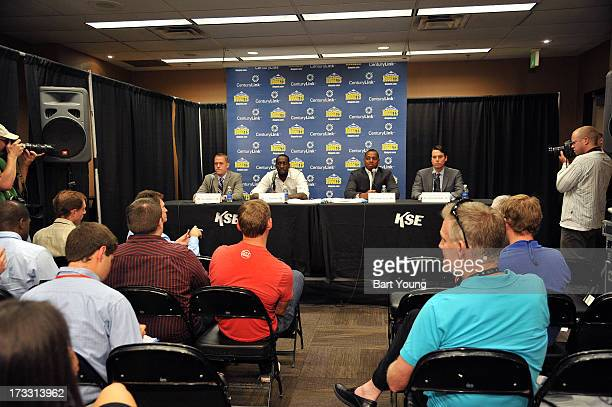 President Josh Kroenke and General Manager Tim Connelly of the Denver Nuggets introduce new players Randy Foye and JJ Hickson during a press...