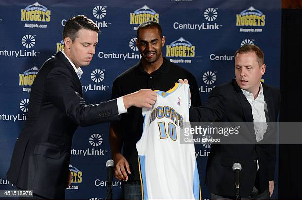 President Josh Kroenke Arron Afflalo and General Manager Tim Connelly of the Denver Nuggets during a press conference to announce the return of Arron...