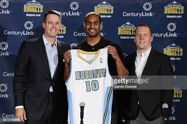 President Josh Kroenke Arron Afflalo and General Manager Tim Connelly of the Denver Nuggets pose for a photo during a press conference on June 30...