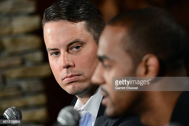 President Josh Kroenke listens to Arron Afflalo of the Denver Nuggets talk to the media during a press conference on June 30 2014 at the Pepsi Center...