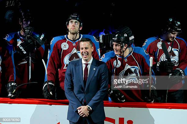 President Josh Kroenke of the Colorado Avalanche laughs on the ice during a ceremony to honor the 20th Anniversary Team before a game against the...