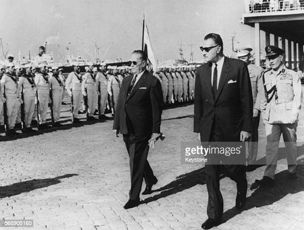 President Josip Broz Tito of Yugoslavia and Egyptian President Gamal Abdel Nasser walking past a Guard of Honor at Alexandria Harbor passengers...