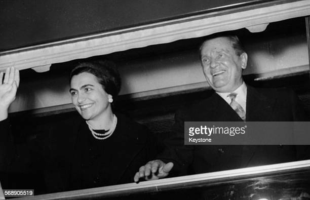 President Josip Broz Tito of Yugoslavia and his wife Jovanka Broz waving from the window of the 'blue train' as they leave Belgrade circa 1965