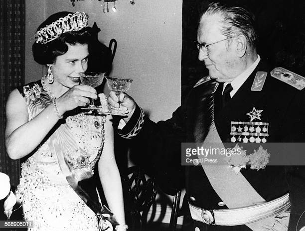 President Josip Broz Tito of Yugoslavia raising a glass to share a toast with Queen Elizabeth II during a State Banquet at Beli Dvor October 20th 1972