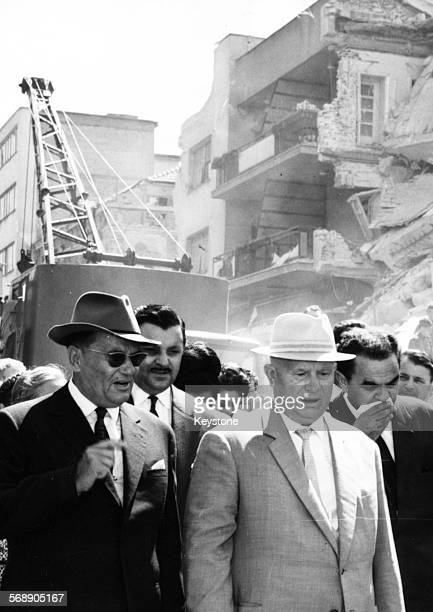 President Josip Broz Tito of Yugoslavia showing Nikita Khrushchev , First Secreatry of the Communist Party of the Soviet Union, around the ruined...