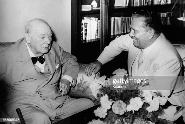President Josip Broz Tito of Yugoslavia sitting with British Prime Minister Winston Churchill during an Adriatic cruise on the yacht 'Christina' at...