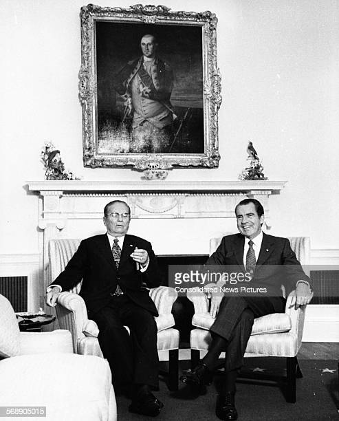 President Josip Broz Tito of Yugoslavia sitting with US President Richard Nixon and smoking a cigar 1971