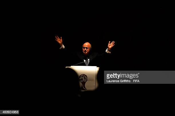 President Jospeh S Blatter raises his hands as he asks the audience to applaud as a sign of respect following news of the death of Nelson Mandela...