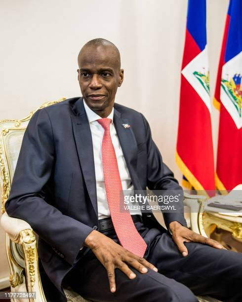 President Jovenel Moise sits at the Presidential Palace during an interview with AFP in Port-au-Prince, October 22, 2019. - Haitians fed up with...