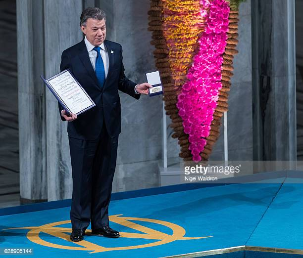 President Juan Manuel Santos of Colombia receives his Nobel Peace Prize Award during the Nobel Peace Prize ceremony at Oslo Town Hall on December 10,...