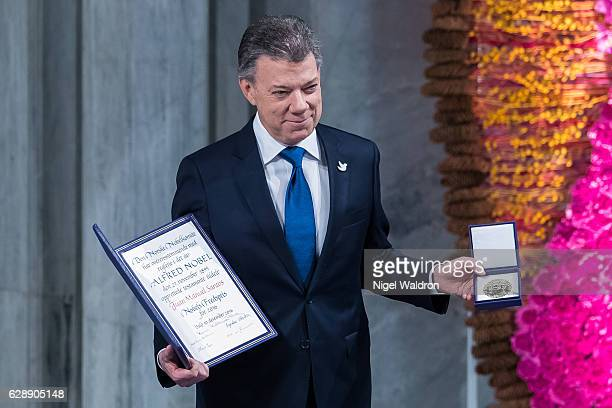 President Juan Manuel Santos of Colombia receives his Nobel Peace Prize Award during the Nobel Peace Prize ceremony at Oslo Town Hall on December 10...