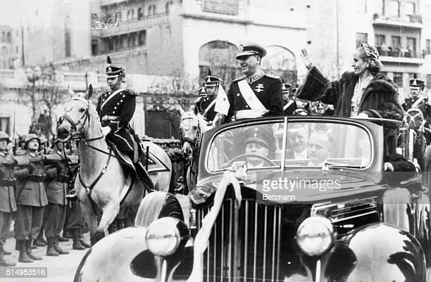 President Juan Peron and First Lady Eva Peron ride in an open car through the Avenida de Mayo in Buenos Aires following Peron's inauguration to a...