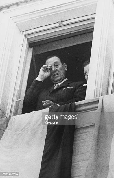 President Juan Peron of Argentina wiping away a tear as he looks down at the crowd form his window 1972