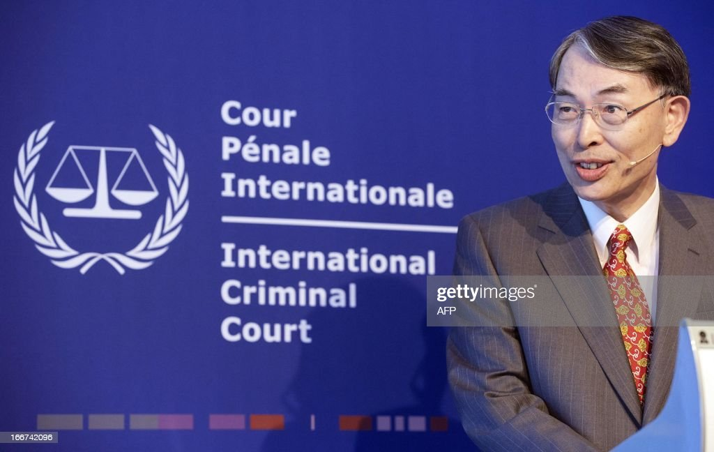 ICC President Judge Sang-Hyun Song gives a speech during the groundbreaking ceremony for the International Criminal Court's (ICC) new premises on the site of the former military barracks Alexanderkazerne in Scheveningen, The Netherlands, on April 16, 2013. The new complex shall consist 1,200 workstations and three courtrooms. AFP PHOTO / ANP - MARTIJN BEEKMAN = netherlands out