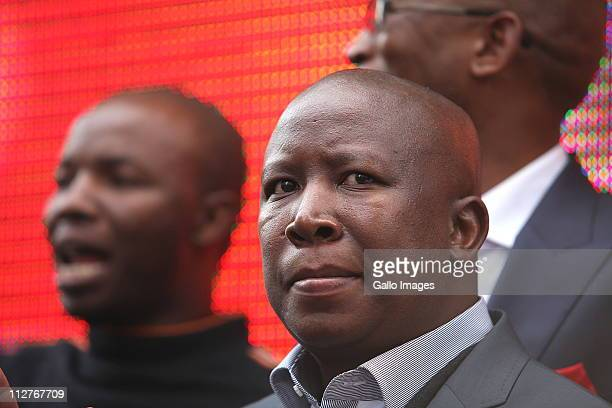President Julius Malema is flanked by ANC members outside the high court on April 20, 2011 in Johannesburg, South Africa. NCYL President Julius...