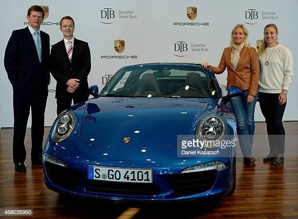 President Karl-Georg Altenburg , head of marketing of Porsche AG Kjell Gruner, head coach Barbara Rittner and Angelique Kerber pose during a DTB...