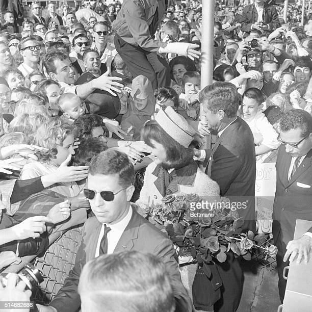 President Kennedy and First Lady Jackie Kennedy greet supporters at the Dallas airport on November 22 1963 Later that day the President will be...