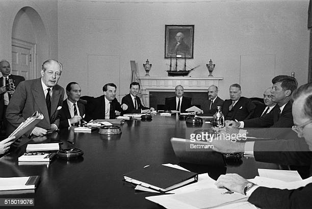 President Kennedy and Prime Minister MacMillan with some of their advisors are shown at start of morning conference at White House here today Left to...