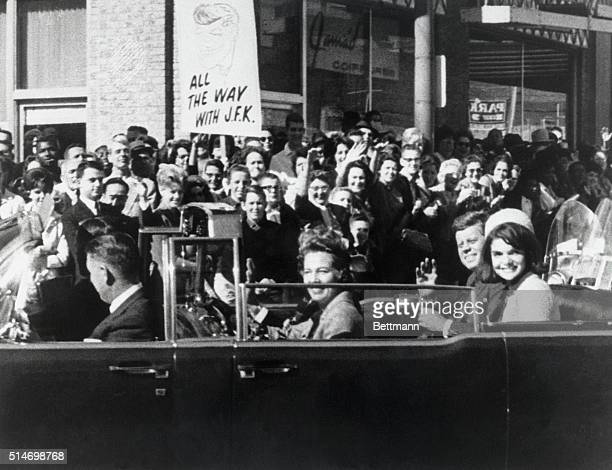 President Kennedy and wife Jackie ride in a motorcade among the crowds in Dallas on November 22 1963 Moments later President Kennedy will be fatally...