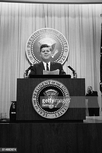 President Kennedy appears at a press conference on January 24 and declared that there was never any plan to employ United States air cover for the...