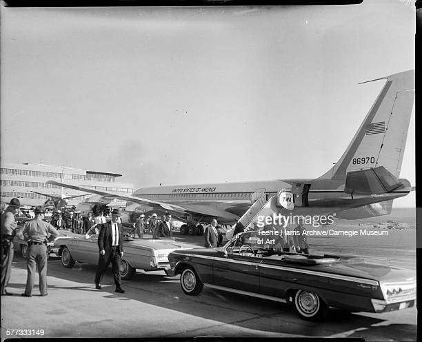 President Kennedy at Allegheny County Airport approaching motorcade cars with Air Force One in background Allegheny County Pennsylvania October 1962