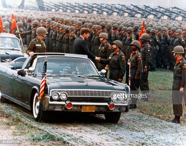 President Kennedy greets the 73rd Artillery unit in Hanau West Germany He shakes hands with an officer while the troops stand in formation A row of...