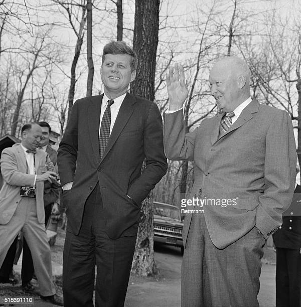 President Kennedy meets with former president Dwight Eisenhower at Camp David after the Bay of Pigs invasion