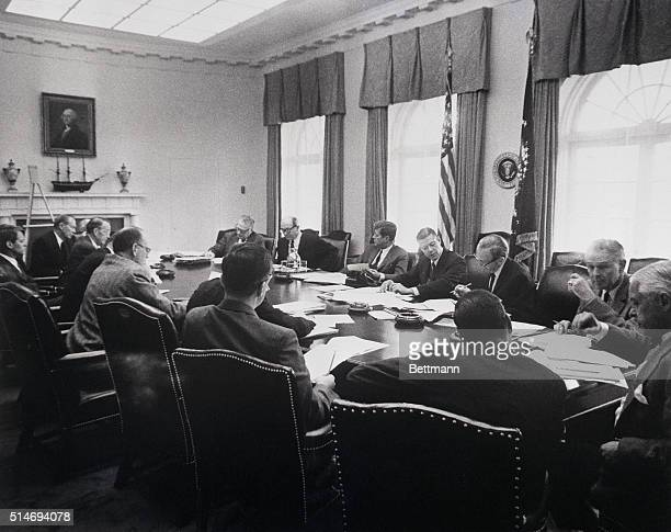 President Kennedy meets with his cabinet officers and advisers in October 1962 about the Cuban missile crisis Seated at the table are Robert Kennedy...
