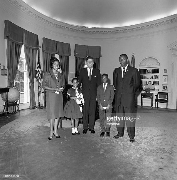 President Kennedy meets with Myrlie Evers two of her children and Charles Evers Medgar Evers' brother on June 21 two weeks after Evers' assassination...